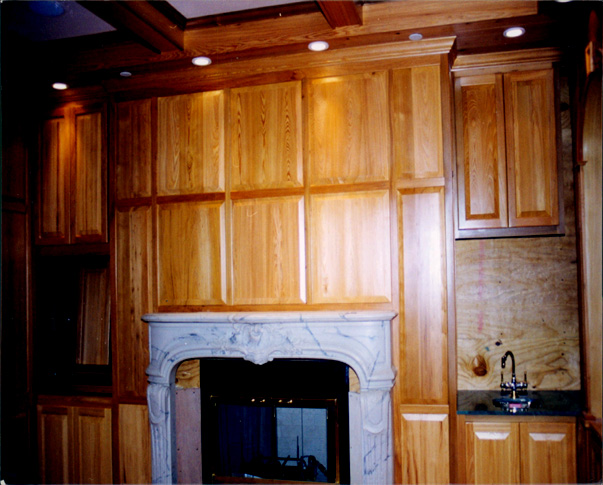 Treehouse Woodworking raised_panel_fireplace_wall1.jpg
